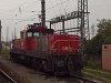 Az ÖBB 1064 008-4 nehéz tolatómozdony Wien Zentralverschiebebahnhof Kledering rendezőpályaudvaron