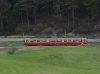 Piros-beige fényezésü  DÜWAG-villamos kapaszkodik Innsbruckból Fulpmesbe