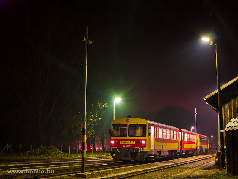 Trains passing by: Bzmot 217 at Nagykálló at night photo
