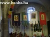The ceremonial flags and the side-altar of the church of Gyöngyöspata