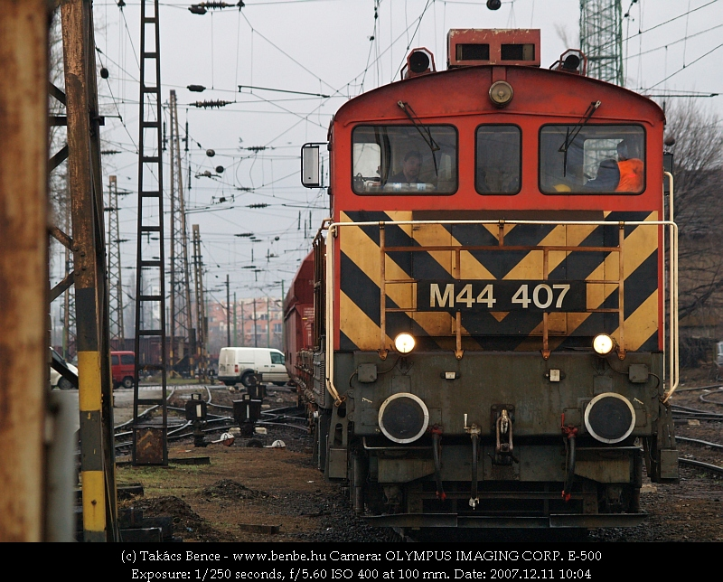 The M44 407 departs from Rákosrendezõ with a freight train photo