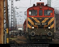 The M44 407 departs from Rákosrendezõ with a freight train