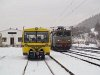 The CFR 40-0198-9 ASEA-licensed locomotive and a yellow track maintenance railcar at Lunca Bradului