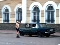 A girl waiting for costumers and her pimp in his Lada at Kolomiya