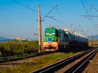 Az UZ ЧМЭ3/CsME3-1031 Munkács-Átrakó és Mezőterebes-Gorond között, Kljucsárki megállónál húz egy tolatós tehervonatot