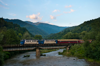 The CFR Calatori 60 1156-8 and 60 1356-9 seen hauling a fast train to Sighetu Marmatiei on the the bridge of the Viseu river between Petrova and Bistra Viseului