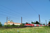 The 1144 272-0 is pushing a push-pull train near the Melk abbey
