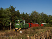 The Mk48,2002 is hauling a mixed passenger/freight train between Sámsoni út logs loading area and Martinka stop
